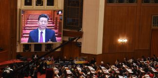 Chinese legislators' historic meeting lauds lifetime power for Xi