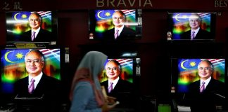 Malaysia's Najib dissolves parliament paving way for tough election
