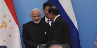President Mamnoon, Modi shake hands at SCO Summit