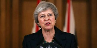 British PM May slaps down ´Stop Brexit´ cry in farewell speech