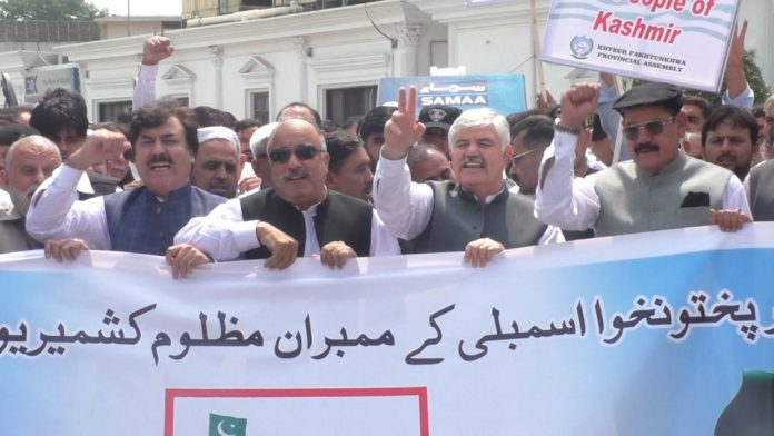 KP Governor, CM lead rally to express solidarity with Kashmiris