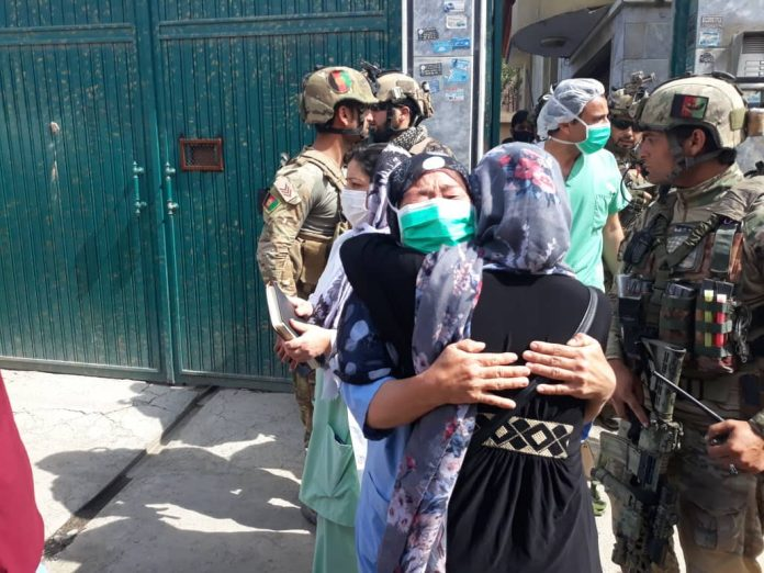 Violence flares in Afghanistan as hospital, funeral attacked