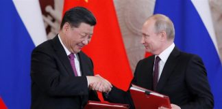 US accuses China, Russia of coordinating on virus conspiracies