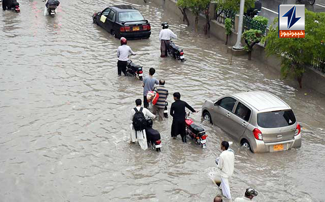 Containers float in rainwater on Karachi's inundated roads